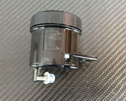 Genuine Ducati black smoke brake fluid reservoir. Ducati part-no. 58540341A repl. 58540221A.